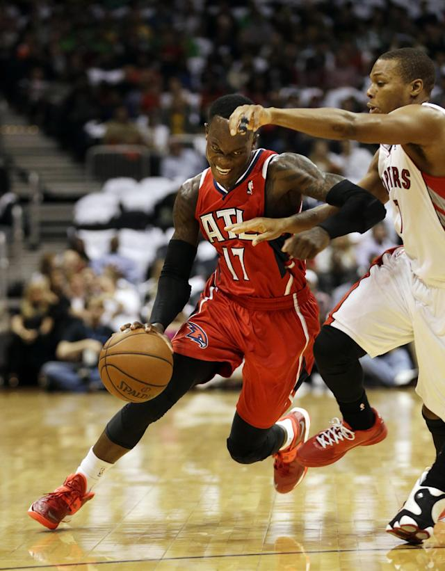 Atlanta Hawks point guard Dennis Schroder (17), of Germany, drives against Toronto Raptors point guard Kyle Lowry in the first half of an NBA basketball game Friday, Nov. 1, 2013, in Atlanta. (AP Photo/John Bazemore)
