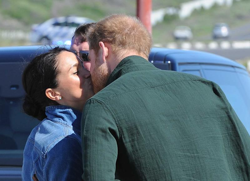 Meghan Markle and Prince Harry share a public kiss. [Photo: Camera Press/Michelly Rall]