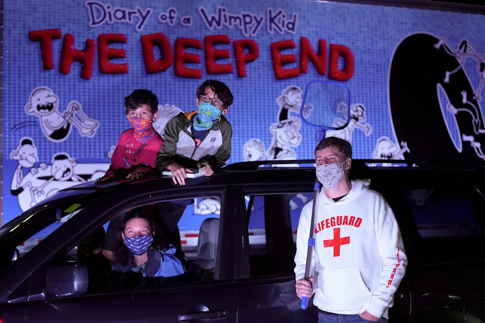 """Families attend a drive-thru pool party event to promote Jeff Kinney's latest kids book, """"Diary of A Wimpy Kid: The Deep End"""" on Oct. 26. in Silver Spring, Maryland."""