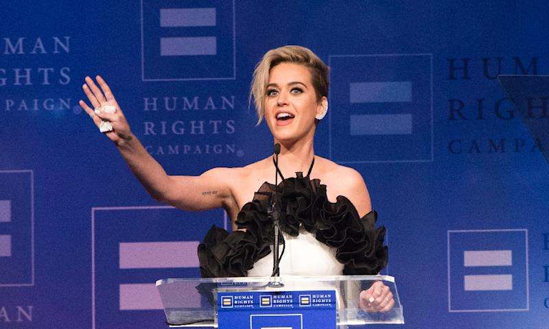 Pop star Katy Perry hailed gay friends for opening her mind as she accepted an award from the Human Rights Campaign in Los Angeles