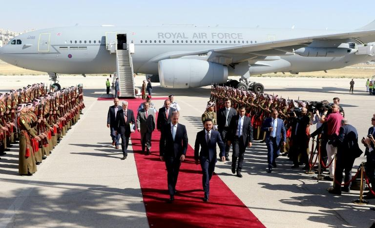 Britain's Prince William and Jordanian Crown Prince Hussein bin Abdullah walk along the red carpet at Amman's Marka military airport at the start of William's tour of the region on June 24, 2018