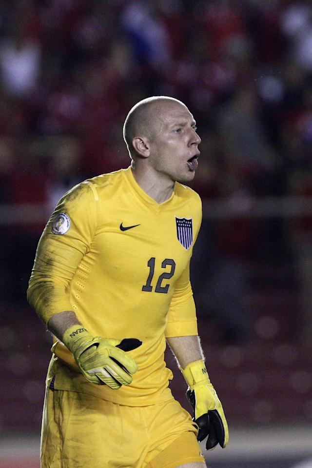 **CORRECTS SPELLING OF SURNAME** U.S. goalkeeper Brad Guzan shouts during a 2014 World Cup qualifying soccer match against Panama, in Panama City, Tuesday, Oct. 15, 2013. (AP Photo/Arnulfo Franco)