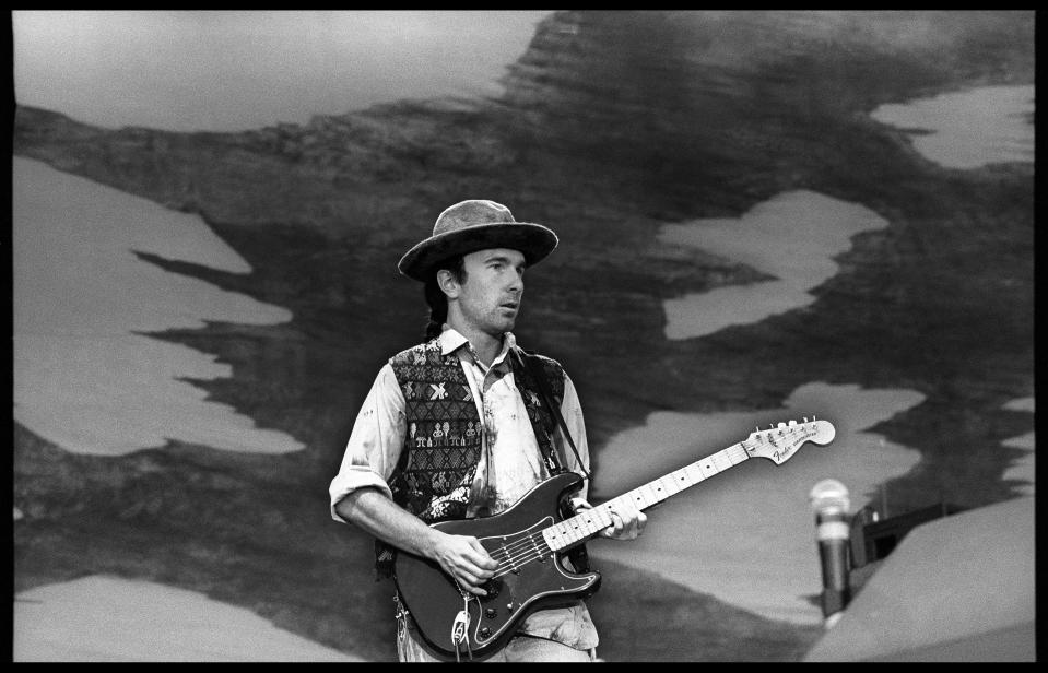The Edge of U2 performs on stage on The Joshua Tree Tour at Feyenoord Stadion, De Kuip, Rotterdam ,Netherlands, 10th July 1987. He is playing a Fender Stratocaster guitar. (Photo by Rob Verhorst/Redferns)