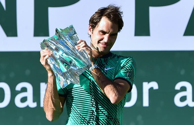 Roger Federer of Switzerland lifts the trophy following his victory over compatriot Stan Wawrinka in the ATP Indian Wells Masters final match, in California, on March 19, 2017