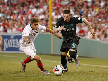 Premier League: Alejandro Pozo's last-minute strike guides 10-man Sevilla to a 2-1 win over Liverpool in pre-season friendly