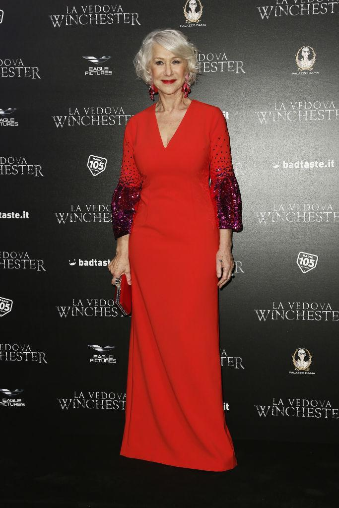 <p>Helen Mirren was a vision in red as she donned a bejewelled bell-sleeve dress by Sachin & Babi to a photocall in Rome. The actress accessorised the look with co-orinating earrings. <em>[Photo: Getty]</em> </p>