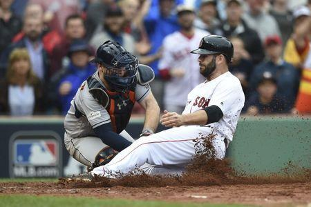 Oct 9, 2017; Boston, MA, USA; Houston Astros catcher Brian McCann (left) tags out Boston Red Sox first baseman Mitch Moreland (right) during the third inning in game four of the 2017 ALDS playoff baseball series at Fenway Park. Mandatory Credit: Bob DeChiara-USA TODAY Sports