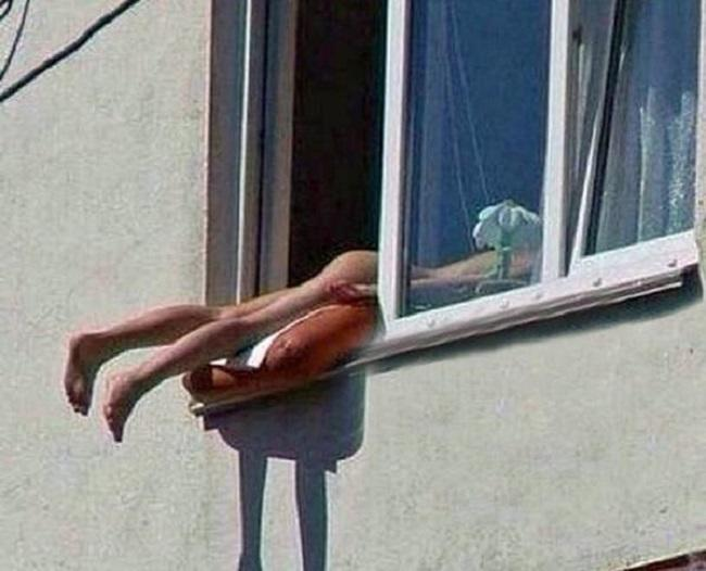 Austrian Nude Sunbather Causes Car Pile-Up After Hanging Bottom Out of Window