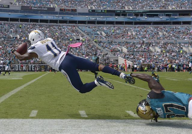 San Diego Chargers wide receiver Eddie Royal (11) catches a 27-yard pass for a touchdown as Jacksonville Jaguars strong safety Johnathan Cyprien, lower right, can't stop him during the first half of an NFL football game in Jacksonville, Fla., Sunday, Oct. 20, 2013.(AP Photo/Phelan M. Ebenhack)