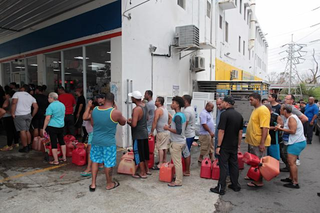 <p>People line up to buy gasoline at a gas station after the area was hit by Hurricane Maria, in San Juan, Puerto Rico, Sept. 22, 2017. (Photo: Alvin Baez/Reuters) </p>