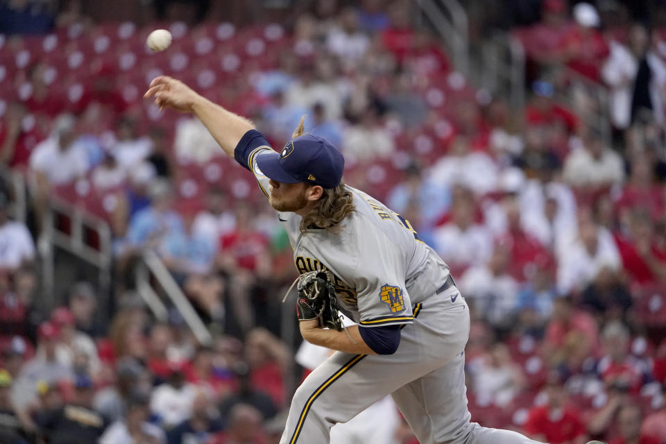 Milwaukee Brewers starting pitcher Corbin Burnes throws during the first inning of a baseball game against the St. Louis Cardinals Tuesday, Aug. 17, 2021, in St. Louis. (AP Photo/Jeff Roberson)