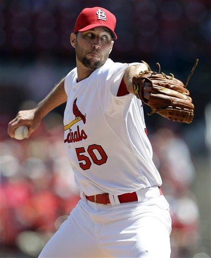 St. Louis Cardinals starting pitcher Adam Wainwright throws during the first inning of a baseball game against the Cincinnati Reds, Thursday, April 19, 2012, in St. Louis. (AP Photo/Jeff Roberson)