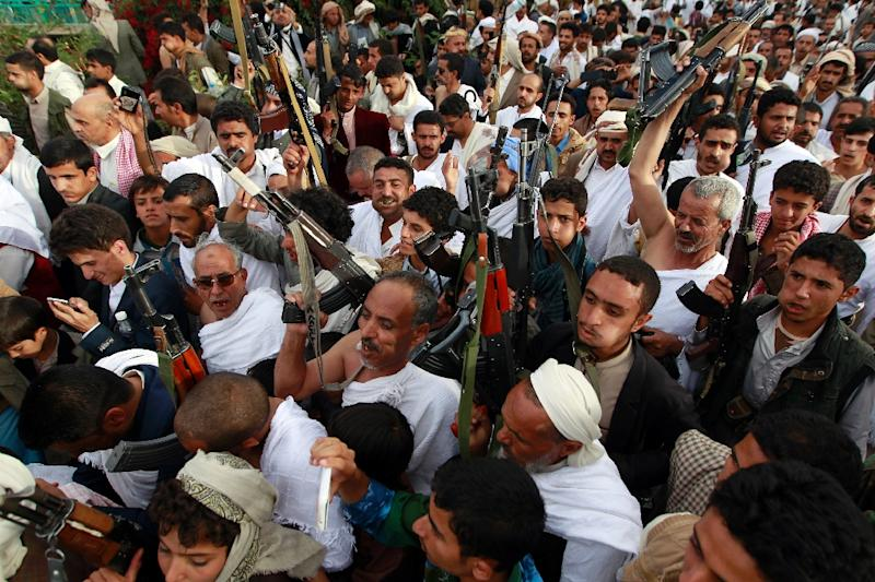 Shiite-Huthi supporters, some wearing traditional attire worns during the Hajj pilgrimage, protest over claims that Saudi Arabia, host to the hajj, was denying Yemenis the right to attend this year's pilgrimage, September 11, 2015