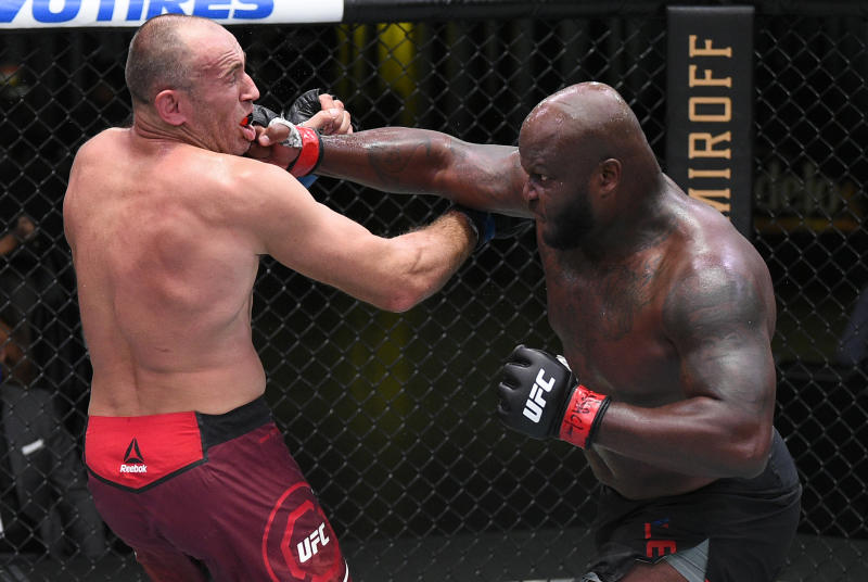 LAS VEGAS, NEVADA - AUGUST 08: (R-L) Derrick Lewis punches Aleksei Oleinik of Russia in their heavyweight fight during the UFC Fight Night event at UFC APEX on August 08, 2020 in Las Vegas, Nevada. (Photo by Chris Unger/Zuffa LLC)