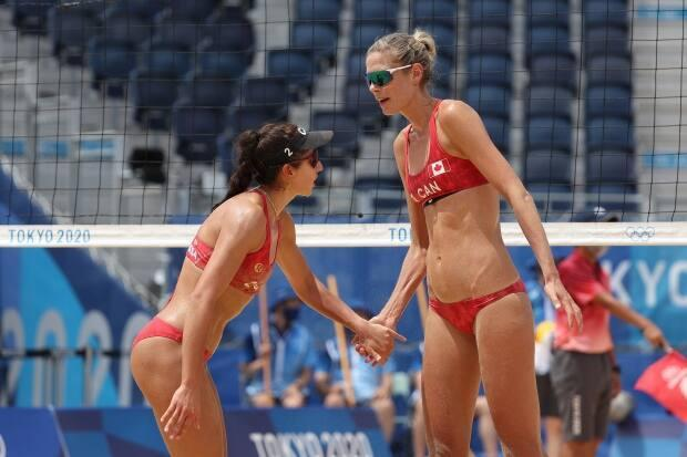 Canada's Sarah Pavan, right, and Melissa Humana-Paredes celebrate their straight-sets win over Spain's Liliana Fernández and Elsa Baquerizo during their first knockout match at the Tokyo Olympics on Monday. (Sean M. Haffey/Getty Images - image credit)