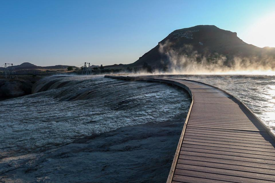 """<p>In Thermopolis, Wyoming, <a href=""""https://wyoparks.wyo.gov/index.php/places-to-go/hot-springs"""" rel=""""nofollow noopener"""" target=""""_blank"""" data-ylk=""""slk:Hot Springs State Park"""" class=""""link rapid-noclick-resp"""">Hot Springs State Park</a> allows visitors to wash away the day in relaxing and therapeutic 104° waters—for free!</p>"""