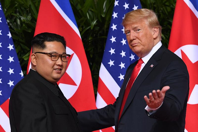 President Donald Trump (R) meets with North Korea's leader Kim Jong Un in Singapore in June 2018 (AFP Photo/SAUL LOEB)