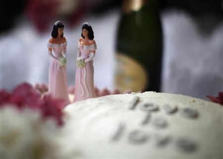 A wedding cake is seen at a reception for same-sex couples at The Abbey in West Hollywood