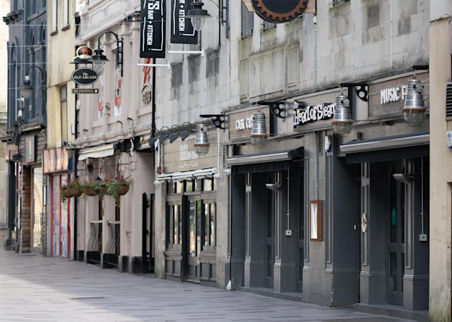 Closed pubs in central Cardiff as the streets of the Welsh capital remained empty in Saturday. (Getty Images)