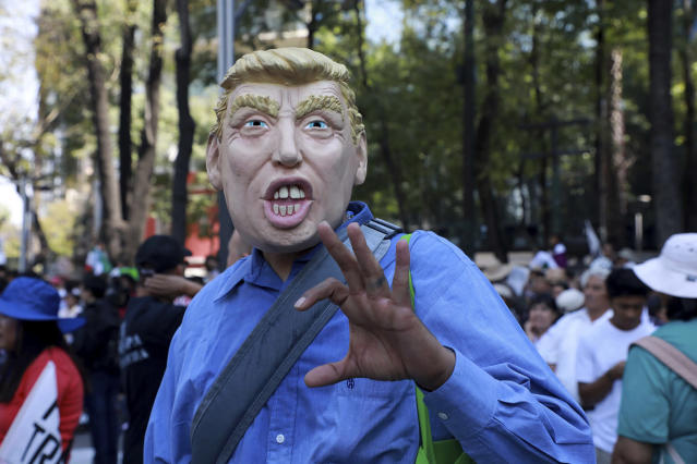<p>A man wears a mask depicting U.S. President Donald Trump during a march demanding respect for Mexico and its migrants, in the face of perceived hostility from the Trump administration, in Mexico City, Feb 12, 2017. (Photo: Christian Palma/AP) </p>