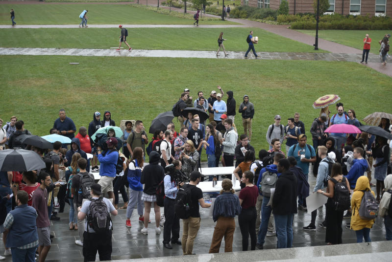 Students gather near a student protest Liberty University in Lynchburg, September 13, 2019. (Taylor Irby/The News & Advance via AP)