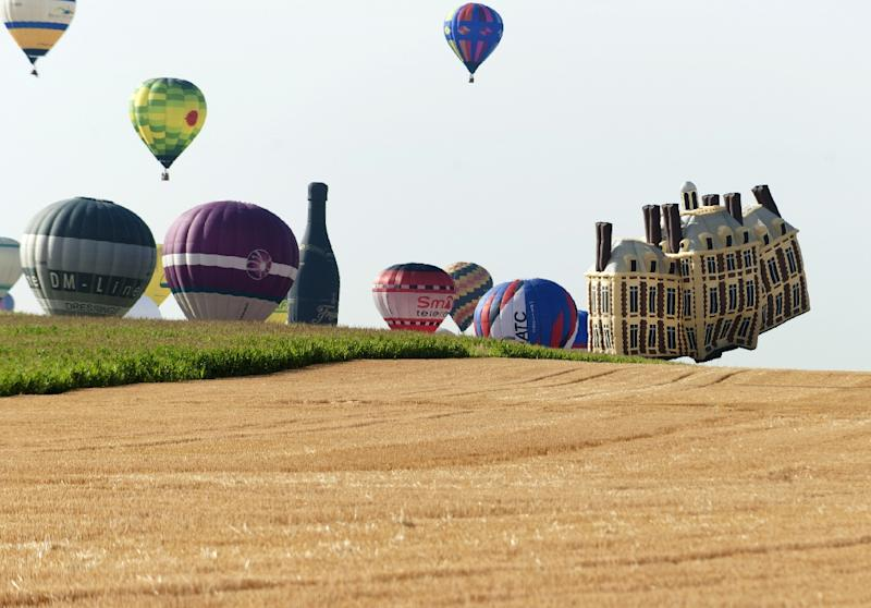 """Hot-air balloons fly near Chambley-Bussieres, eastern France, on July 26, 2015, marking the first day of the """"Lorraine Mondial Air Ballons"""""""