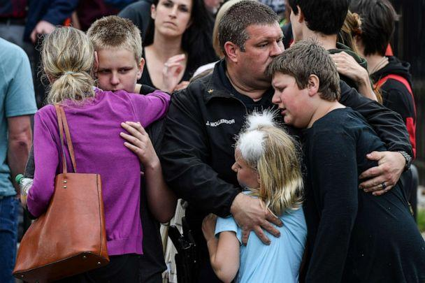 PHOTO: A police officer hugs his kids after they were evacuated to the Recreation Center at Northridge after at least seven students were injured during a shooting at STEM School Highlands Ranch on May 7, 2019, in Highlands Ranch, Colorado. (Michael Ciaglo/Getty Images, FILE)