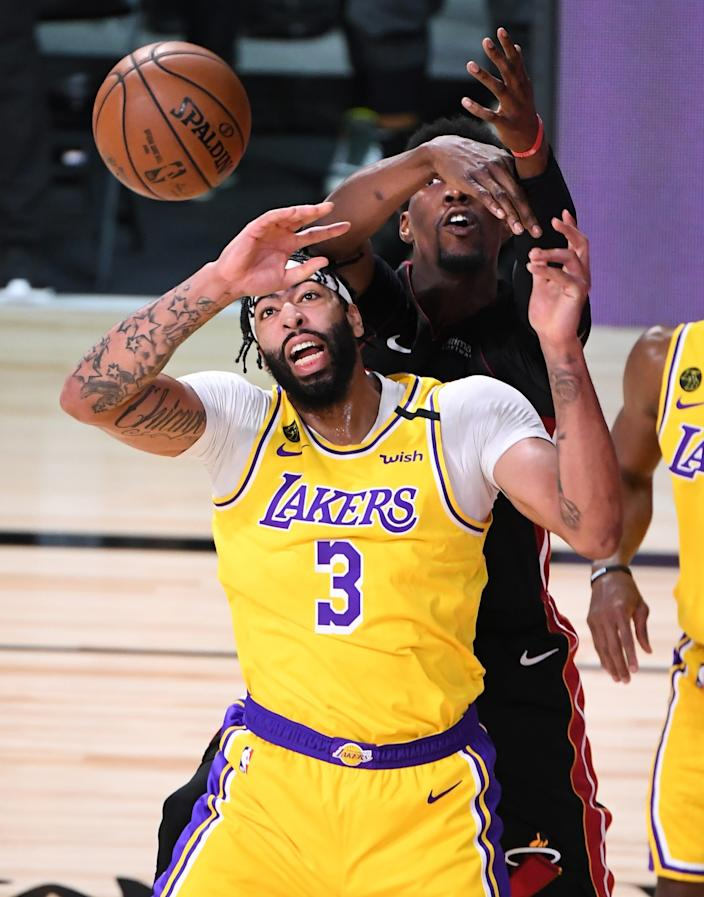 Lakers forward Anthony Davis and Heat center Bam Adebayo collide as they battle for a rebound during Game 1.