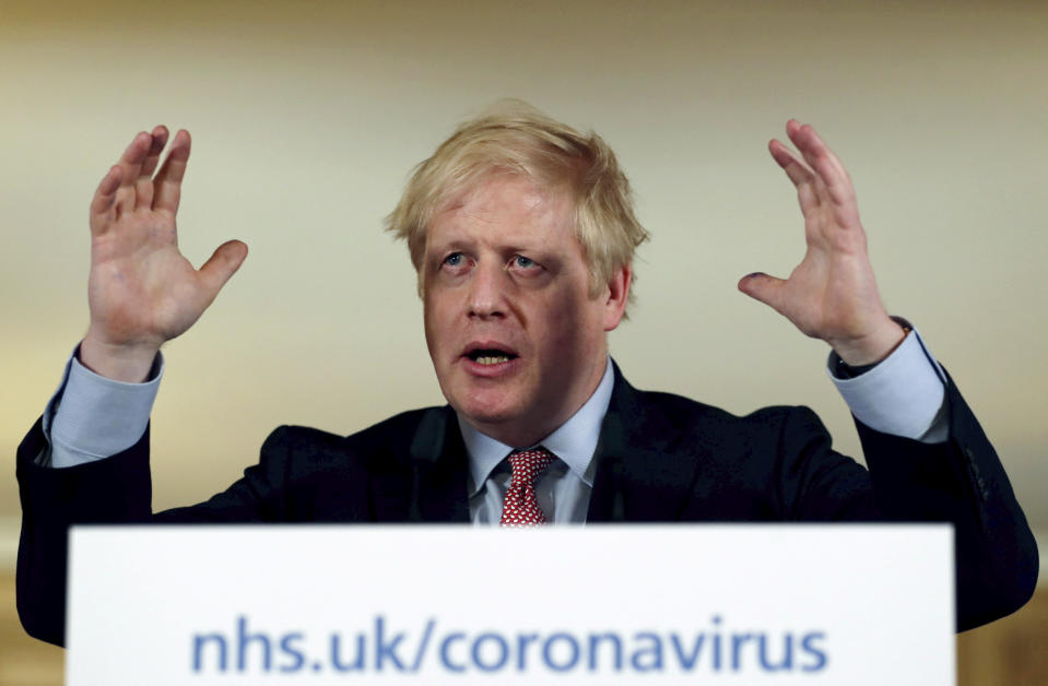 Britain's Prime Minister Boris Johnson holds a news conference to give the government's response to the new COVID-19 coronavirus outbreak, at Downing Street in London, Thursday March 12, 2020. For most people, the new COVID-19 coronavirus can cause only mild or moderate symptoms, but for some it can cause more severe illness. (Simon Dawson/Pool via AP)