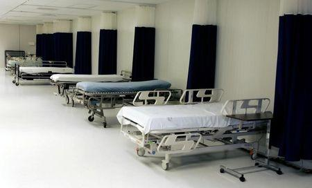 Hospital beds are seen at Camp Delta where some detainees have been tube-fed wh..