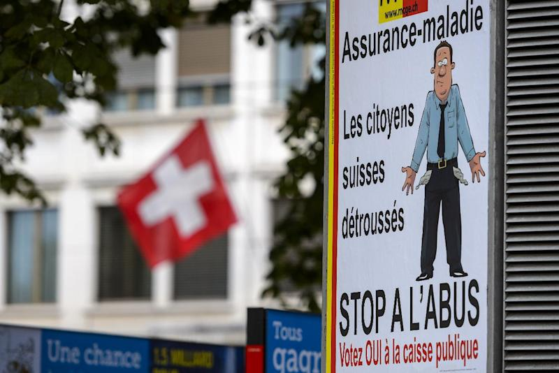 Campaign posters promoting a single public health insurance system are seen on September 21, 2014 in Geneva (AFP Photo/Fabrice Coffrini)