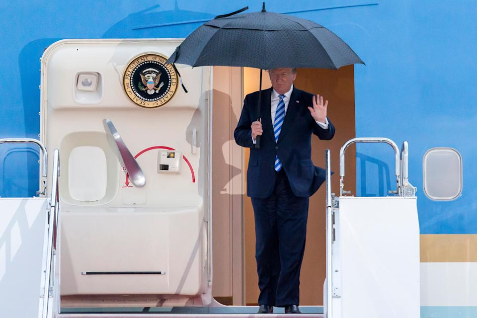 U.S. President Donald Trump waves as he arrives for the G-20 Osaka summit. (Photo: Tomohiro Ohsumi via Getty Images)