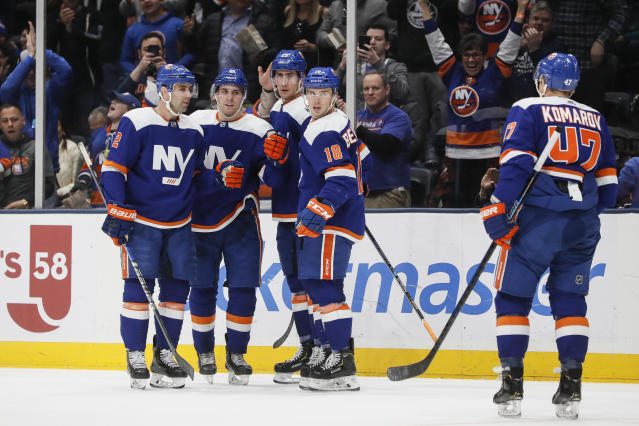 New York Islanders defenseman Devon Toews, second from left, celebrates his goal during the second period of an NHL hockey game against the San Jose Sharks, Sunday, Feb. 23, 2020, in Uniondale, N.Y. (AP Photo/John Minchillo)