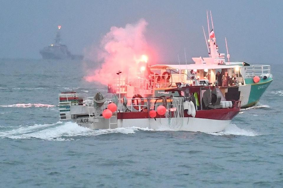 <p>A French vessel sets off a flare</p> (Jersey Evening Post / SWNS)
