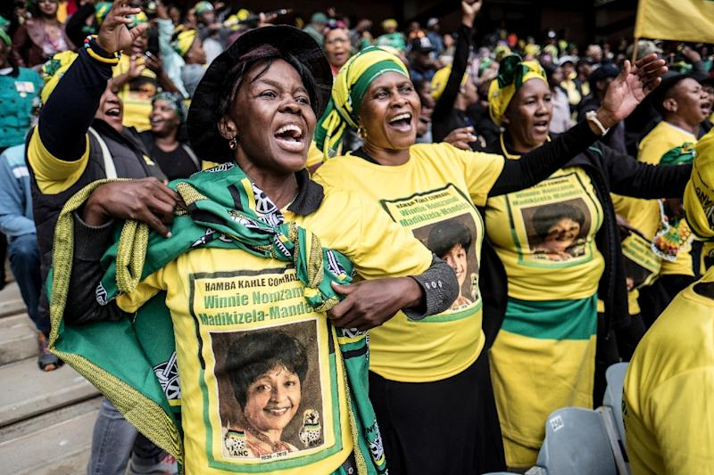 The ruling ANC's signature green, yellow and black adorned mourners' shirts and flags and women's head-wraps (AFP Photo/MARCO LONGARI)