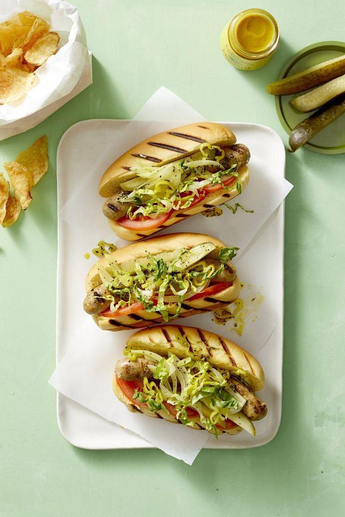 """<p>If you want to keep the hot dog tradition in sports snacking, but you're looking for a bit of a lighter option, you've found it: chicken sausage instead of regular hot dog meat. <br></p><p><em><a href=""""https://www.womansday.com/food-recipes/food-drinks/a22687839/chicago-style-chicken-dogs-recipe/"""" rel=""""nofollow noopener"""" target=""""_blank"""" data-ylk=""""slk:Get the Chicago-Style Chicken Dogs recipe."""" class=""""link rapid-noclick-resp"""">Get the Chicago-Style Chicken Dogs recipe.</a></em></p>"""