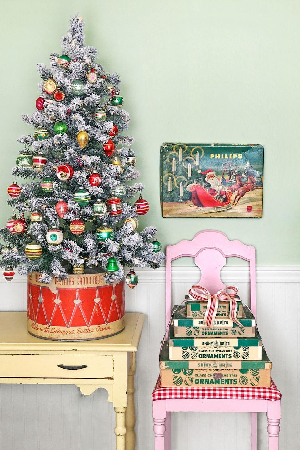"""<p>What an adorable, tiny tree! We love the idea of using a vintage candy box as a tree stand for any <a href=""""https://www.countryliving.com/home-design/decorating-ideas/g316/decorate-mini-christmas-trees/"""" rel=""""nofollow noopener"""" target=""""_blank"""" data-ylk=""""slk:mini tree"""" class=""""link rapid-noclick-resp"""">mini tree</a>. A cookie tin would work beautifully too.</p><p><a class=""""link rapid-noclick-resp"""" href=""""https://www.amazon.com/iPEGTOP-Glittering-Shatterproof-Christmas-Ornaments/dp/B07D8N86GV?tag=syn-yahoo-20&ascsubtag=%5Bartid%7C10050.g.1247%5Bsrc%7Cyahoo-us"""" rel=""""nofollow noopener"""" target=""""_blank"""" data-ylk=""""slk:SHOP CHRISTMAS ORNAMENTS"""">SHOP CHRISTMAS ORNAMENTS</a></p>"""