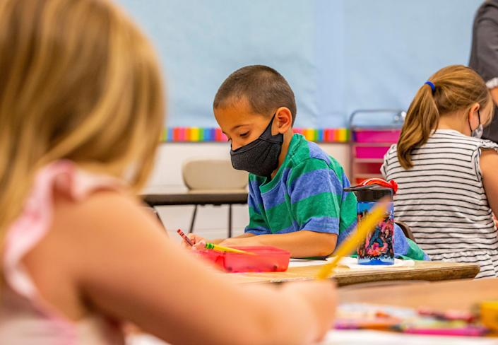 Paetyn Rasing, 5, wears a mask Tuesday during a pre-K summer program at Swanson Traditional School in South Bend, Ind.