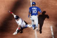 Boston Red Sox's Bobby Dalbec, left, makes the play at first base after Toronto Blue Jays' Marcus Semien (10) grounded into a double play during the sixth inning of a baseball game, Saturday, June 12, 2021, in Boston. (AP Photo/Michael Dwyer)