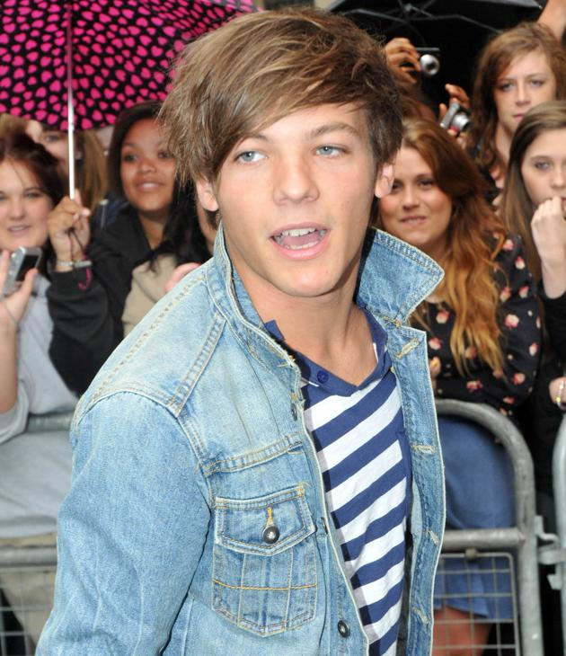 Louis Tomlinson photos: Louis looks a bit overwhelmed by all the screaming girls. He best get used to it.