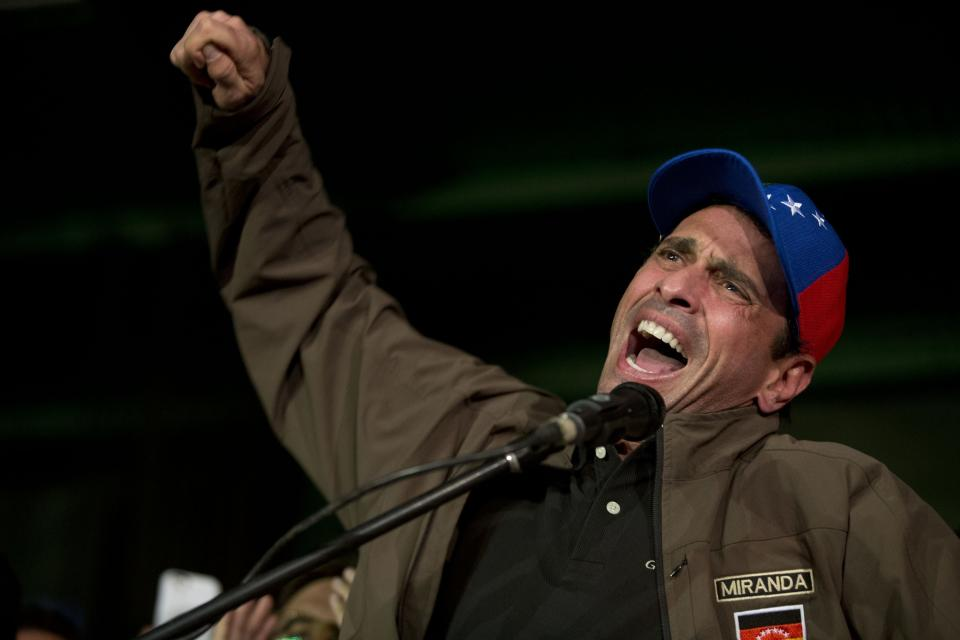 Venezuelan opposition leader Henrique Capriles speaks to supporters and reporters during a meeting in Caracas, Venezuela, Friday, April, 7, 2017. Capriles announced that he has been banned from running for office for 15 years, a move sure to ratchet up tensions amid a growing street protest movement. (AP Photo/Ariana Cubillos)