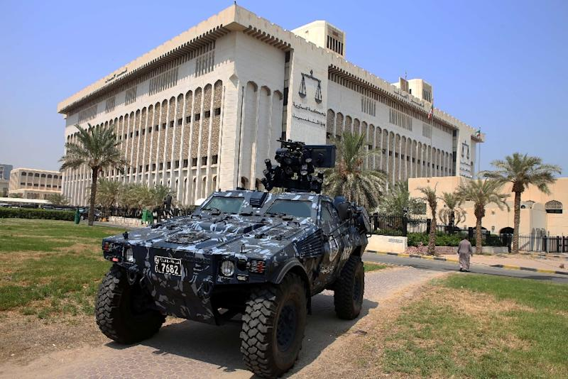 Security forces guard the courthouse in Kuwait City where 29 people are on trial for their roles in a deadly attack on a Shiite mosque on June 26 (AFP Photo/Yasser al-Zayyat)