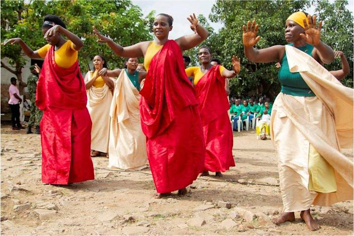 Female prisoners dance at the launch.