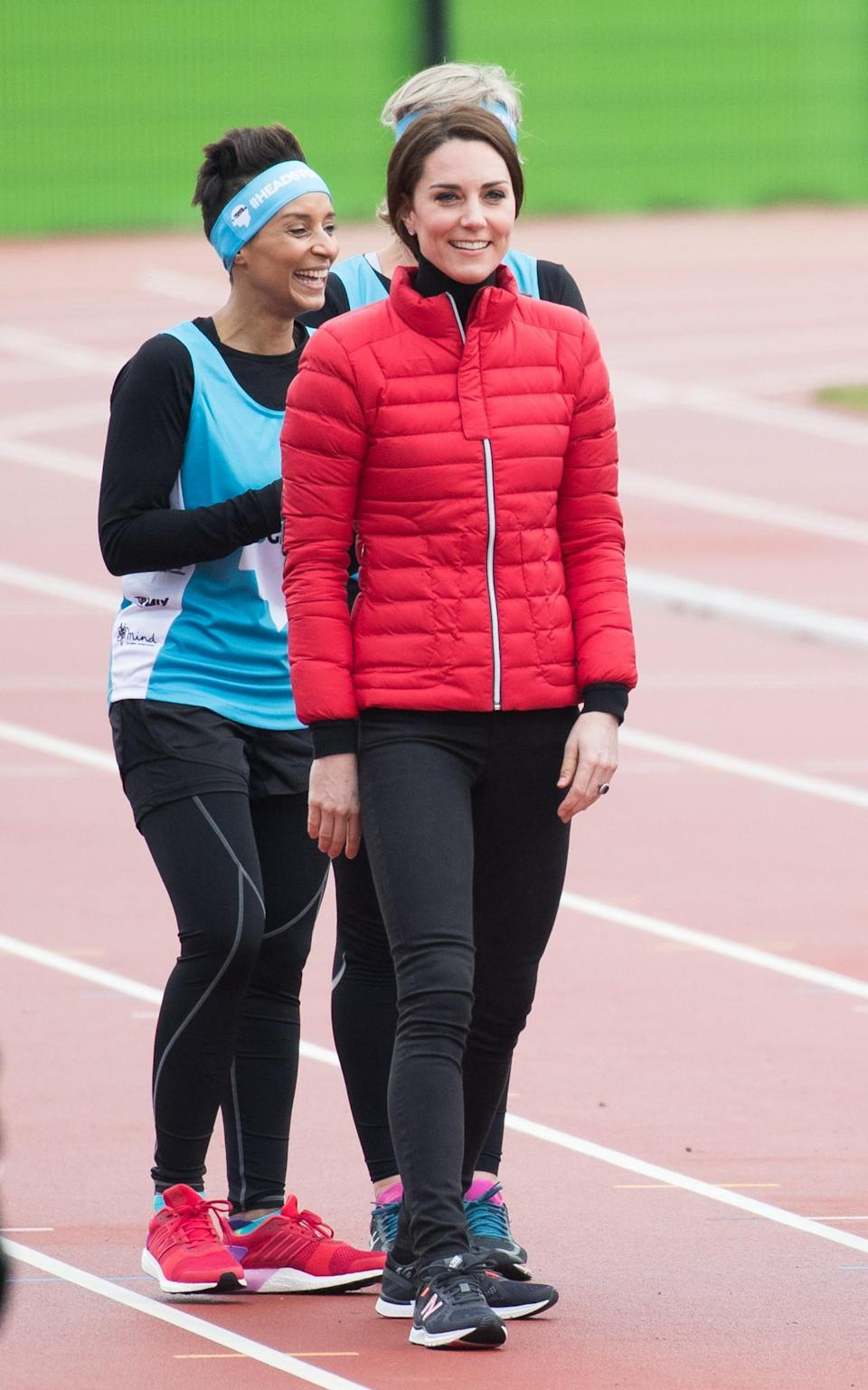 <p>For a marathon training session, the Duchess got on board with the puffer coat trend, choosing a style by French brand, Perfect Moment. She paired the look with black skinny jeans and New Balance trainers.<br><em>[Photo: PA]</em> </p>