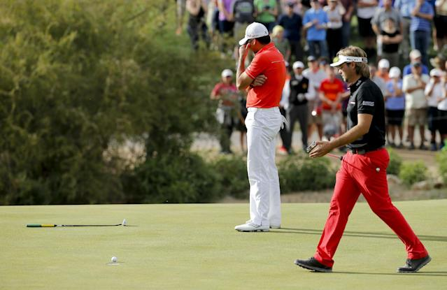 Jason Day, of Australia, left, reacts after missing the winning putt on the 18th hole in his championship match against Victor Dubuisson, of France, during the Match Play Championship golf tournament on Sunday, Feb. 23, 2014, in Marana, Ariz. (AP Photo/Matt York)