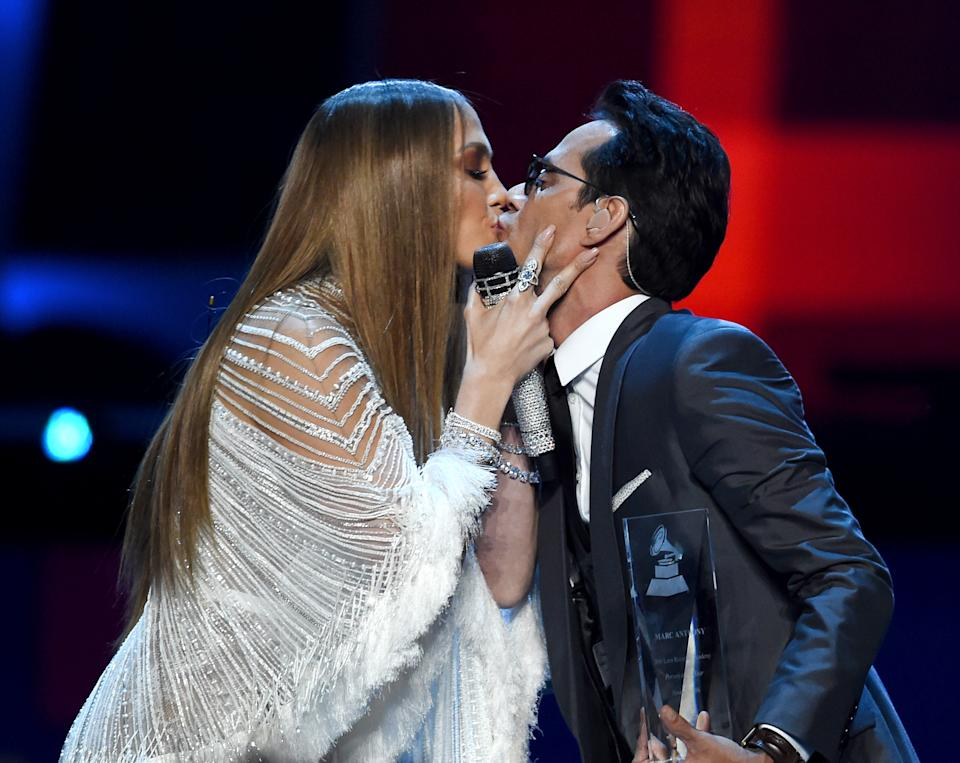 LAS VEGAS, NV - NOVEMBER 17:  Singer/actress Jennifer Lopez and singer Marc Anthony kiss onstage during The 17th Annual Latin Grammy Awards at T-Mobile Arena on November 17, 2016 in Las Vegas, Nevada.  (Photo by Kevin Winter/WireImage)