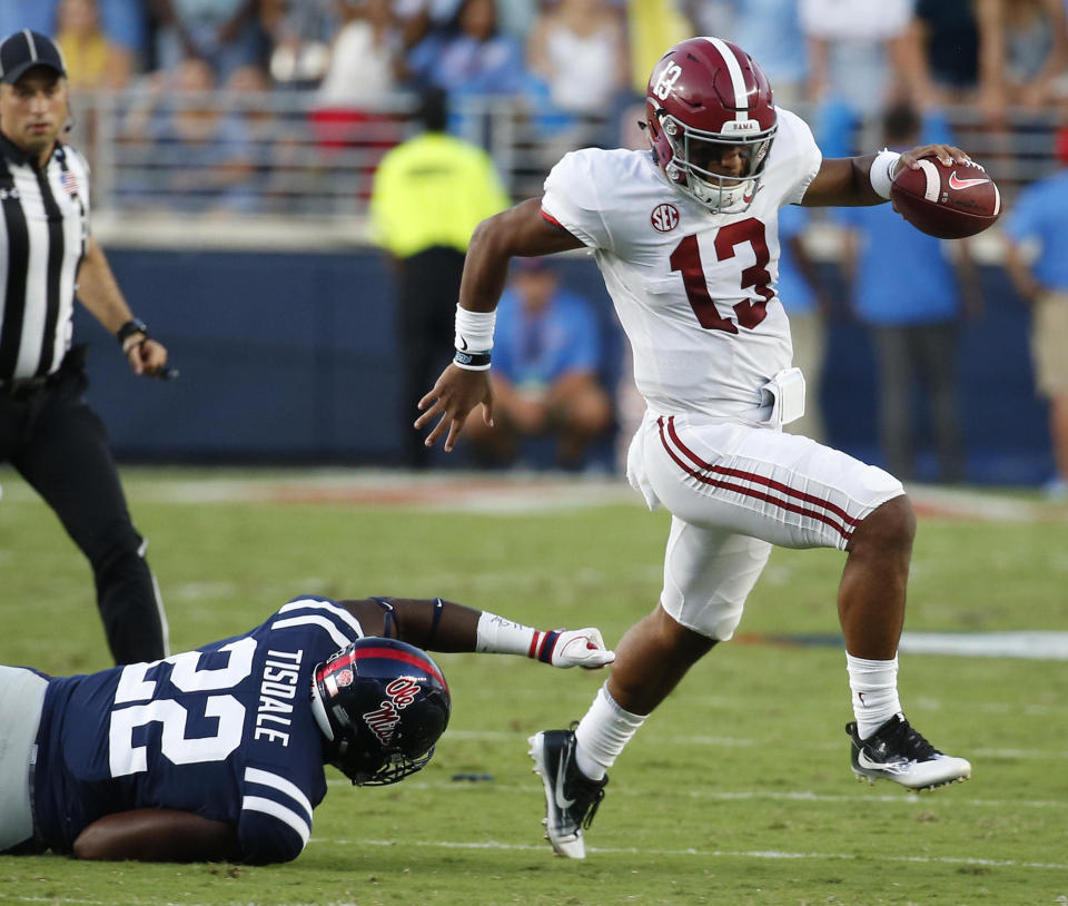 Tua Tagovailoa (13) and the Crimson Tide have been rolling early on this season. (AP)