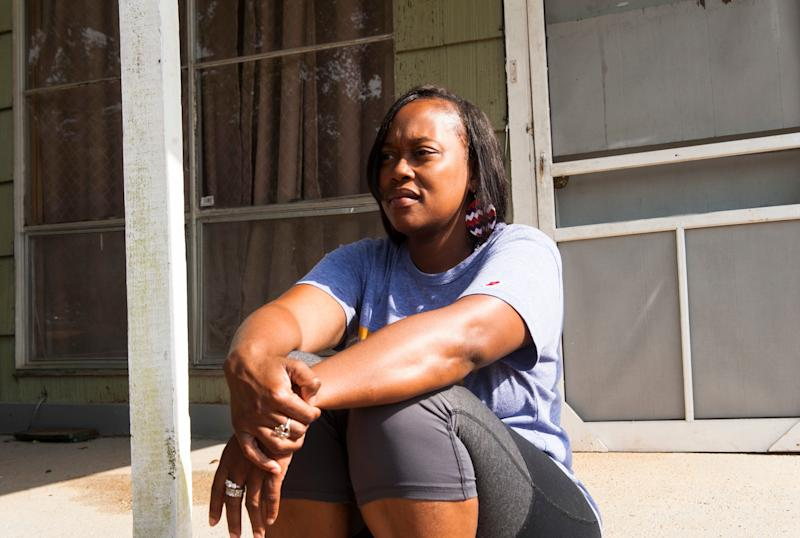 Sheena Godbolt, 33, sits on her sister's porch in Bogue Chitto.