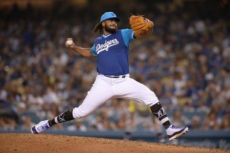FILE PHOTO: Aug 25, 2018; Los Angeles, CA, USA; Los Angeles Dodgers relief pitcher Kenley Jansen works against a San Diego Padres batter during the ninth inning at Dodger Stadium. Mandatory Credit: Orlando Ramirez-USA TODAY Sports
