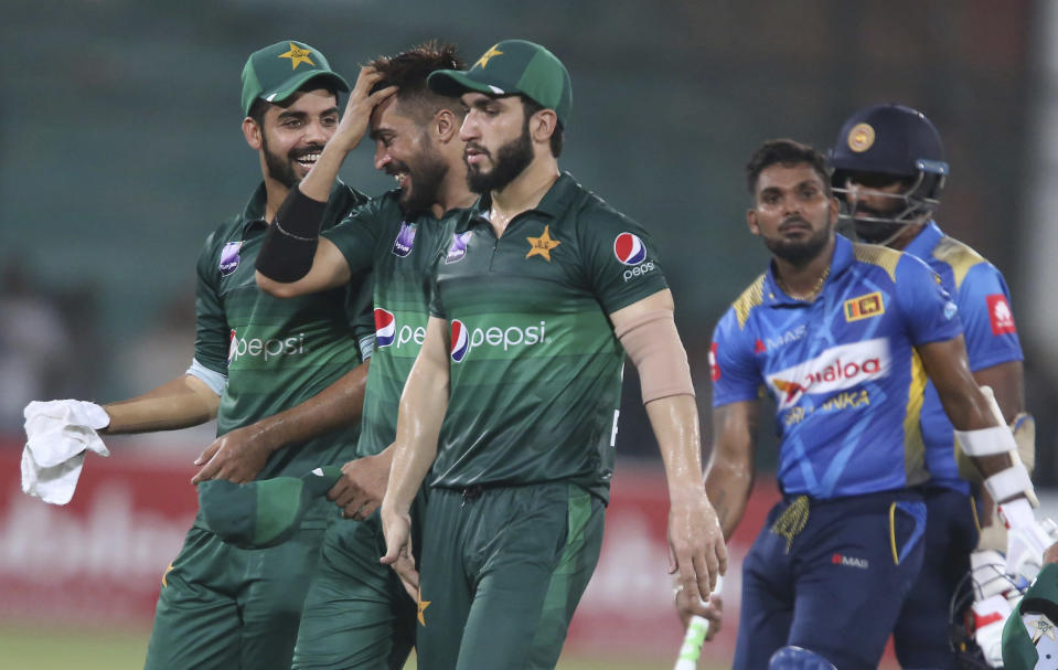 Pakistani players celebrate their victory against Sri Lanka in the second one-day international in Karachi, Pakistan, Monday, Sept. 30, 2019. Pakistan marked return of ODI cricket in Karachi after 10 years with a 67-run victory over Sri Lanka in the second one-day international of the three-match series on Monday. (AP Photo/Fareed Khan)
